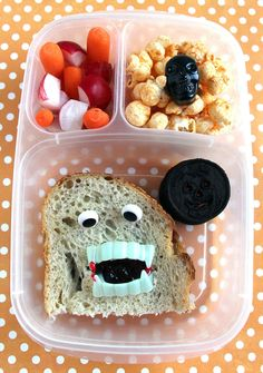 Vampire Sandwich | Martha Stewart Living - Be careful! This sandwich might bite you back! To make a vampire sandwich cut a hole in the top slice of bread on a peanut butter and jelly sandwich. Tuck some toy vampire teeth inside and add a couple of eye decorations to make a vampire face. A little dab of jam on the end of the fangs makes it even scarier.