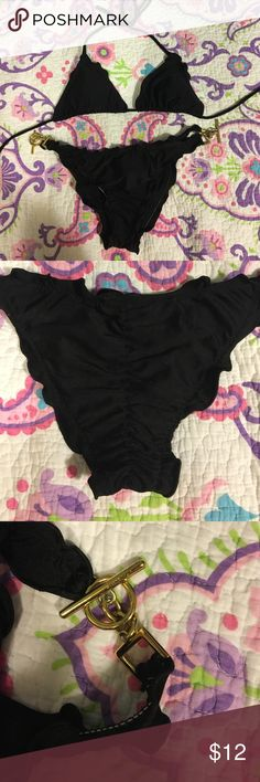 Black brazilian bikini set. Size M Ritchie's bikinis (Coconut Grove, Miami, FL). Matching black brazilian/cheeky cut bikini set with ruffle trim. Bottom has ruched back and gold hardware accents. Good condition- worn once, in Dubai. Padding included with top. Swim Bikinis