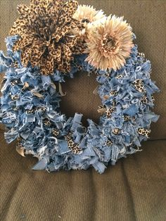 Blue Jean Wreath. Cut into strips, wash and dry to fray and tie with spandex ribbon.