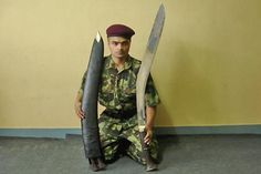 "The Gorkha trooper displays a giant ""kukri"" knife, the traditional Nepalese rifle used as both a tool and a weapon. Note that the scabbard contains an additional two (smaller) ""kukris"". In the hands of trained men, the ""kukri"" is a fearsome weapon that can easily sever a limb with one strike."