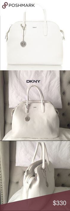 DKNY WHITE TOTE BAG DKNY TRIBECA WHITE TOTE BAG BRAND NEW WITH TAGS AND DUSTER BAG! Extra leather long strap inside to attach. Very hard to find! DKNY Bags Totes