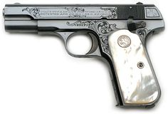 "Colt Model 1903 Pocket Hammerless serial number 492737 Exhibition Piece - Factory ""A"" engraved Model M in .32 caliber."