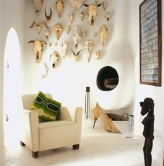 Timeless and contemporary: watched over by myriad skulls, this eclectic room feels rather like a modern day Lascaux.