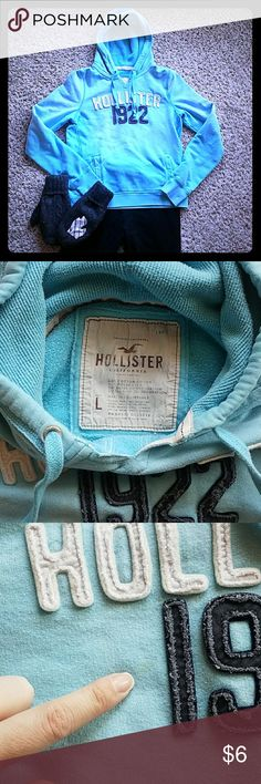 "Hollister | Vintage Faded Hoodie Soft and cozy ""vintage"" Hollister hoodie. Pretty faded blue color. Loved this hoodie! Two stains noted - one faint stain next to the 1, and one on the left sleeve cuff. I did my best to scrub them out. Otherwise a super cute hoodie! No rips or holes! Clean, smoke-free home! Hollister Tops Sweatshirts & Hoodies"