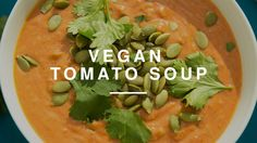 The Best Vegan Spicy Tomato Soup w Tim Shieff | Madeleine Shaw | Wild Dish  1 TBSP OLIVE OIL 4 SPRING ONIONS, FINELY CHOPPED 2 GARLIC CLOVES, CRUSHED 1 TBSP FRESHLY GRATED GINGER 1 TSP PAPRIKA 1 TSP GROUND CUMIN 2 TBSP ALMOND BUTTER 400G CAN CHOPPED TOMATOES 400ML CAN COCONUT MILK OR VEGETABLE STOCK 3 TBSP TOMATO PUREE FRESH HERBS AND SEEDS, TO SERVE SALT AND FRESHLY GROUND BLACK PEPPER, TO TASTE