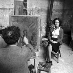 Alberto Giacometti in his studio with a model