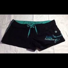 Billabong Board Shorts Cute black and teal embroidered shorts.  Front pocket has Velcro closure, cute teal stitching and button. Side and back stitching in muti-teal colors. Lace front. 3 inch inseam. 100% Polyester.  Worn twice, in excellent condition. Size 5 Billabong Shorts