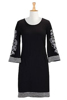 Elaborate embellishment with a wordly feel accents the floaty bell sleeves of our cotton knit shift embroidered with a banded stripe hem and cuffs.