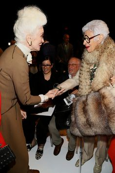 Model Carmen Dell'Orefice (L) and Iris Apfel attend the Ralph Rucci fashion show during Mercedes-Benz Fashion Week Spring 2014 at The Theatr...