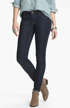 dark wash skinny jeans.  tan ankle boots, chambray shirt.