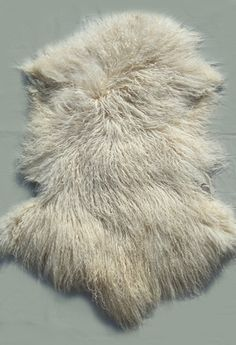 This is a professionally dyed whole, individual, unsewn Tibetan lamb pelt. Tibetan lamb pelts are perfect for many projects: one of a kind dolls, bears, etc., or as decorative rugs or throws for your home.