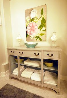 Bathroom Chest... TAKE OUT drawers from an old dresser for open storage, could use baskets or just put towels open like this... paint it pretty and there you go!