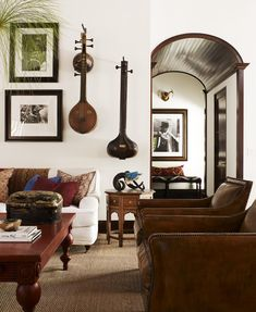"""Bohemian Living Room-frommoontomoon.blogspot.com-Bohemian doesn't always mean """"loud and colourful""""...I am loving the sitars....."""