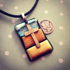 Fused glass pendant with cross made by Leisa Artus
