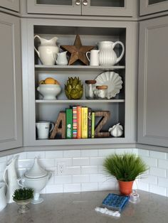 Want to add style to your kitchen shelves? A collection white pottery, fun wooden letters, greenery, colorful cookbooks and accessories all found at HomeGoods makes this kitchen corner functional, chic and oh so Happy. Sponsored Happy by Design Post.