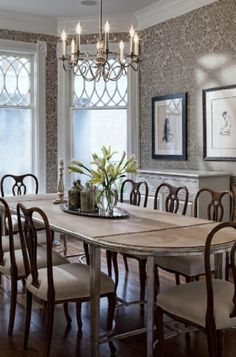 dining room. damask wallpaper. chandelier.