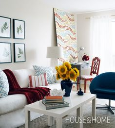 Cheap & Cheery Living Room   House & Home  In the corner, a plywood panel wallpapered with a colourful floral pattern acts as a large art piece. (A cheap and easy way to add patterned wallpaper to a rental without angering the landlord.)