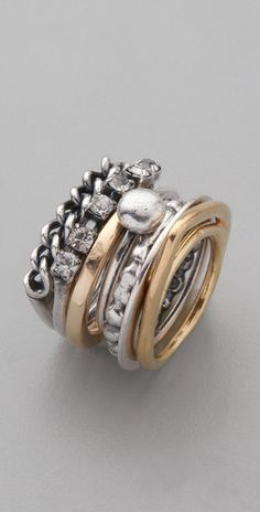 """""""7 unique sterling-silver and gold-plated rings features cubic zirconia stones and a chain detail"""" perfectly describes my personality!"""
