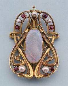 "Edward Colonna, Buckle, 1900. Sculpted gold set with opal, pearls, garnets. France, Made for Siegfried ""Samuel"" Bing's display at the 1900 Paris World's Fair.  Via Cooper Hewitt"