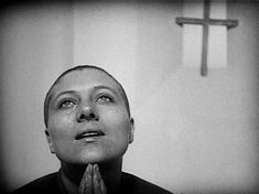 **The Passion of Joan of Arc (La passion de Jeanne d'Arc) - French- (1928) Maria Falconetti, Eugene Silvain, André Berley Director: Carl Theodor Dreyer - The story of Joan's trial, with the dialogue taken directly from the Vatican's transcripts of the trial.  Stark, pared down to just the important elements, this is some of the rawest emotion I've ever seen on film.