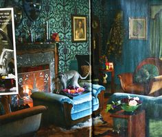 Dita Von Teese's living room is gorgeous.  Her turquoise blue & black walls look as if they are covered in lace!