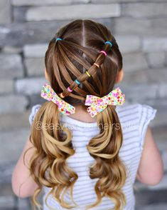 Connected ponies with the other ponytail pulled through it and into curly pigtails. Inspiration came from @pr3ttygirl79. Hers has a braid and we decided to do a connected ponytail. This one is simple and SO pretty! Pigtail bows from @kates.bows