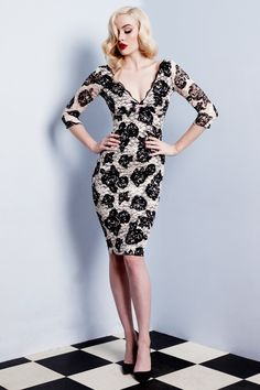 Our classic Fifi Dress is reimaged this season in a chic and elegant winter style.  Demi-sheer lace features a striking Jardin Noir floral with black rosettes printed over delectable classic crème lace. This elegant knee length style is lined in seductive stretch power net to sculpt an hourglass silhouette. The deep V neckline defines a sweeping décolletage and is accented with delicate French Chantilly lace edging and plush velvet bow at centre. Fifi Dress features plunging  ...