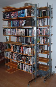 2 Bookcases attached to pivots. They fold against one wall or open to access every shelf. Great space saver.