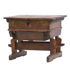This is a 19th Century painted pine desk, which we believe to probably be Hungarian. It is bearing the date 1846, the sliding top encloses an arrangement of drawers and wells above a polychrome painted panel and sliding work box below. It is raised on sledge bases.  It has a lovely piece of writing on the inside of one of the drawers which we assume is Hungarian as the 'pengö' was the currency of Hungary before the 'forint' replaced it. Both of the words pengö and forint are clearly visible.