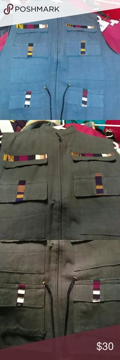 Men's  Beautiful vest. Gray color Black inside,colora on pockets ,brown,burgundy,White and Black.never worn,strap on waist. No tags.pic #2 real color. Other