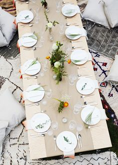 layered cushions, Turkish kilims + foraged herb centerpieces complete this gorgeous bohemian-style tablescape