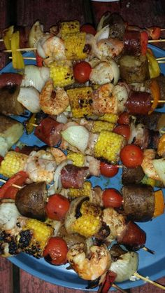 Cajun Shrimp Boil Kabobs:  pre boil baby potatos, corn, and sausage in cajun seasoning until almost done.  When cool add to skewer with uncooked tomatoes, shrimp, onions, mushrooms.  Grill until all ingredients are cooked.