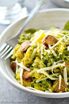 Spaghetti squash loaded with flavorful pesto and lots of sliced sausage! An easy and healthy skillet dinner with only 7 ingredients - all clean eating approved! Pin now to make this healthy dinner recipe later. Sausage And Spaghetti Squash, Spaghetti Squash Recipes, Zucchini Spaghetti, Cooking Recipes, Healthy Recipes, Keto Recipes, Skinny Recipes, Healthy Options, Clean Recipes