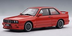 """1990 BMW M3 Sport Evolution 1:43 scale diecast car in Red. Part # Autoart 50561 1:43 Scale diecast car. The die cast measures approximately 4"""" long and comes in a plastic display case. The hood on this diecast opens. Click on the picture for more information about this diecast car!"""