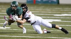 Skyline's Trevor Barney intercepts a ball intended for Camas' Dylan White. (Photo by Colin Diltz / The Seattle Times)