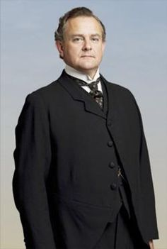 Downton Abbey ~ Robert Crawley, Earl of Grantham (b.1869) the patriarch of Downton Abbey, is the son of the late Patrick and Violet Crawley. He is the brother of Lady Rosamund, the husband of Cora Crawley nee Levinson, He is the father of three daughters: Lady Mary, Lady Edith and Lady Sybil. Tom Branson is his son-in-law and Matthew Crawley is his son-in-law, third cousin and heir. He is the grandfather of Lady Sybil and Lady Mary's children.