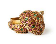 Jewelled opium box, North India, circa 1800 Gold with kundan set rubies, emeralds and diamonds.