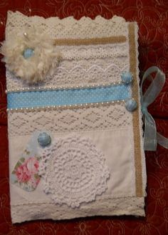 A Journal, Notebook, Guest Book, quilt padded, which is really a cover and can be used over and over again, as the Notebook/Journal can slip in there.  The Front is embellished with a French lace handmade fabric flower with a Aqua colored button, a white doilies and a band of Aqua polka dotted ribbon , pearls.  Hand it down as an Heirloom in the future, so many precious uses. The rest of this Journal is made of vintage lace, on some spot a bit damaged, from my Great-Grandmother's han...