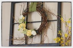 Wreath, fabric flowers and refinished/repurposed old window = Spring mantel.