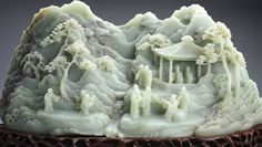 This jade carving is absolutely exquisite. The best thing about it is the fineness of the workmanship. The outline os the tree leaves, the pagoda, the layered landscape make this piece of museum quality. The jade is of a nice uniform color and decent translucence.