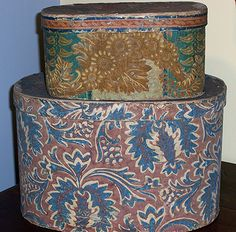 """Stack of Wallpaper Boxes Top Box: Made by Mary Ripley, Hartford, October 26th, 1824. 7"""" wide, 11"""" long, 5 ¾"""" high.  Bottom Box: Large Floral wallpaper in blue and cream over red. 15"""" long, 10 ½"""" wide, 10"""" high."""