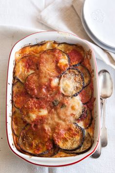 When aubergine parmigiana is served at the table I quickly choose the largest serving, the one oozing mozzarella and parmesan, the one with the golden crisp crust.