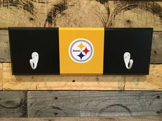 A personal favorite from my Etsy shop https://www.etsy.com/listing/468735130/pittsburgh-steelers-2-hook-hat-coat-rack