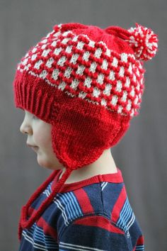 This Pom-Pom Earflap Hat is all about doubles--it's knit in two colors, is topped with two pom-poms, and of course has two earflaps to fend of the winter chill! This knit hat pattern is specially designed for children.