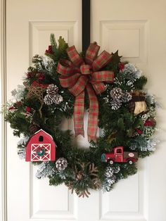 Fantastic holiday wreath! So many cute details to include a barn with a wreath on the door, a farm delivery truck, an owl, a 3 D twine star,