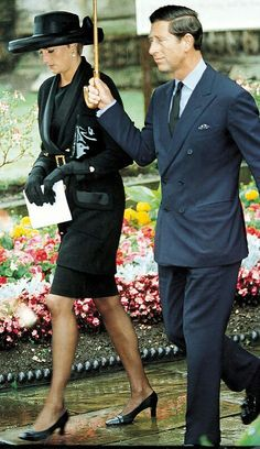 Diana and Prince Charles.  This black outfit with hat is one of my favorites of Diana's Suits.  It's businesslike, feminine and powerful at the same time.