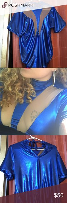 Metallic blue Body Suit with sheer Wonder Woman inspired bodysuit. Perfect for a birthday or event! Very comfortable and stretchy! The sheer makes the boob part very flattering! It is def a Statement maker! Custom designer can fit XLarge to 3x.  Not ASOS!!! Custom designer!!! ASOS Curve Tops