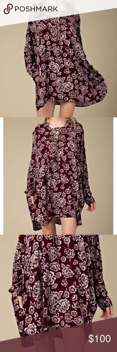 LACE UP DRESS Floral Printed Bohemian Swing Tunic Available Sizes: S/M & M/L. New With Tags.  • Beautiful floral printed swing dress which can also be worn as a tunic, depending on style preference! • Features a pocket at each side hip, long sleeves & optional lace up neckline closure.  • High-low style hemline adds sophistication. • Unlined, however not sheer.  Rayon.       {Southern Girl Fashion - Closet Policy}   ✔Bundle discount: 20% off 2+ items.   ✔️ Item has been discounted to its…