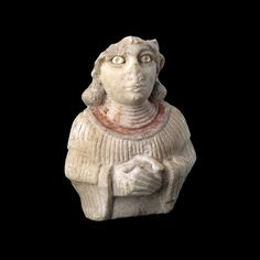 Sumerian stone statue of a woman, ca. 2600 BCE, Ur.