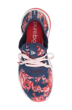 A subtle arch gap furthers the modern look of this lightweight training shoe in a cute floral print.
